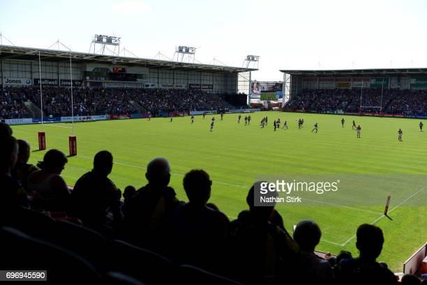 Spectators watch on during the Ladbrokes Challenge Cup QuarterFinal match between Warrington Wolves and Wigan Warriors at Halliwell Jones Stadium on...