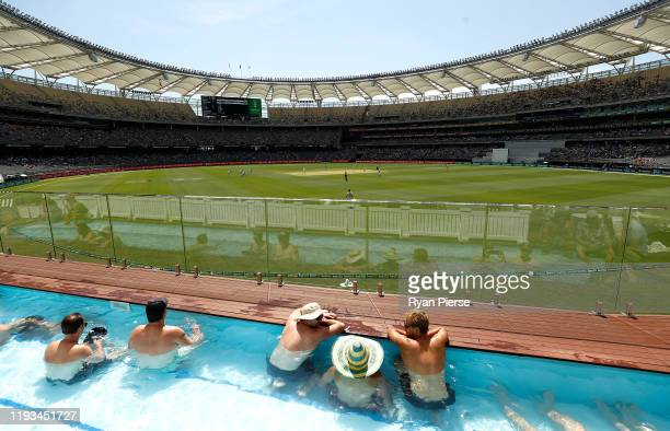 Spectators watch on from the pool in the Boundary Beach Club during day one of the First Test match between Australia and New Zealand at Optus...