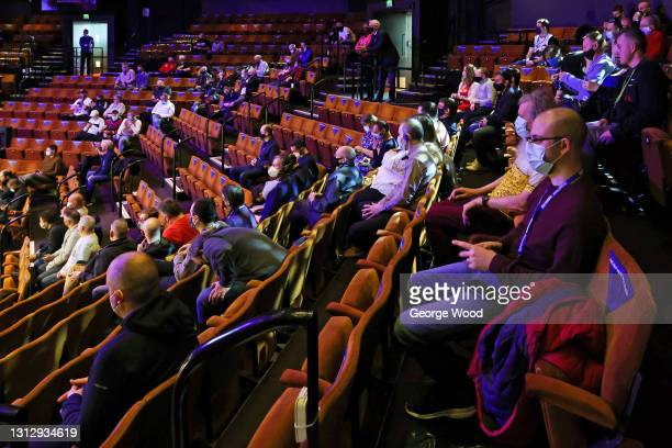 Spectators watch on prior to the Betfred World Snooker Championship Round One match between Ronnie O'Sullivan and Mark Joyce at Crucible Theatre on...