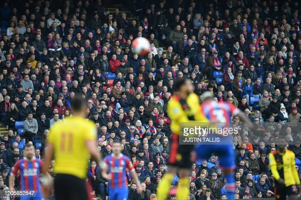 Spectators watch play during the English Premier League football match between Crystal Palace and Watford at Selhurst Park in south London on March 7...