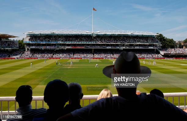 Spectators watch play on the first day of the first cricket Test match between England and Ireland at Lord's cricket ground in London on July 24 2019...