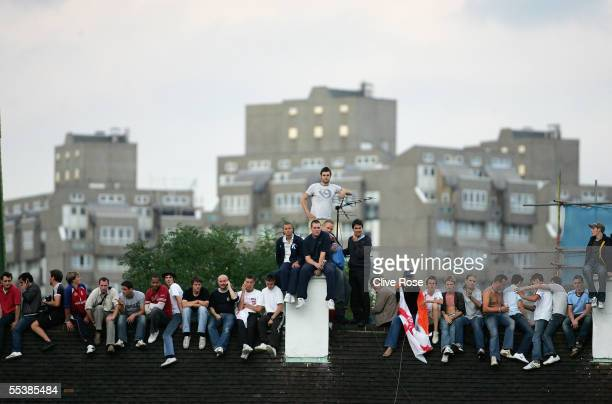 Spectators watch proceedings from the roof of house outside of the ground during day five of the fifth npower Ashes Test match between England and...