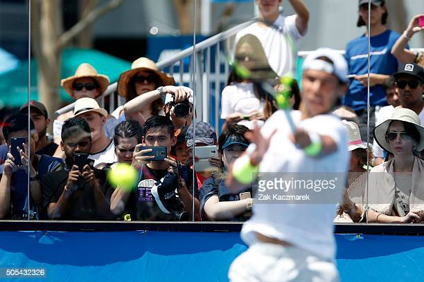 Spectators watch Rafael Nadal in a practice session during day one of the 2016 Australian Open at Melbourne Park on January 18 2016 in Melbourne...
