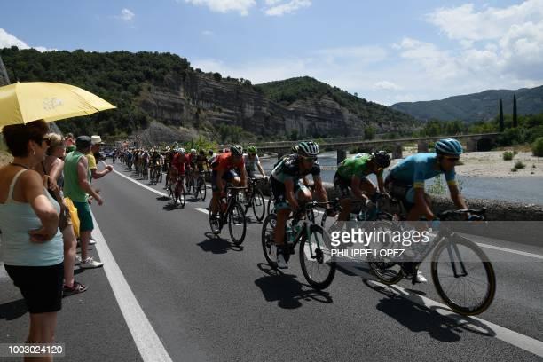 Spectators watch Spain's Omar Fraile Slovakia's Peter Sagan wearing the best sprinter's green jersey and Poland's Maciej Bodnar leading a 32men...