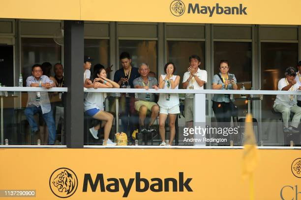 Spectators watch the 18th green during Day One of the Maybank Championship at Saujana Golf Country Club Palm Course on March 21 2019 in Kuala Lumpur...
