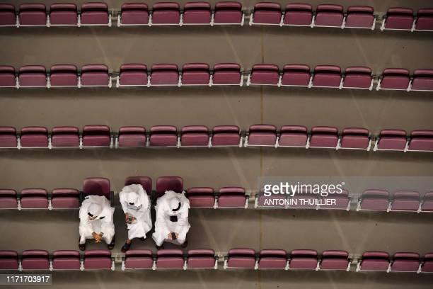 Spectators watch the 2019 IAAF World Athletics Championships at the Khalifa International stadium in Doha on September 28, 2019.