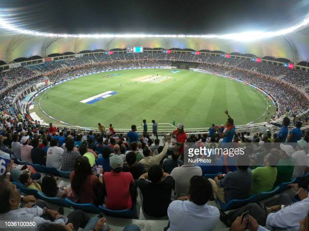 Indian cricket fans cheer during the 5th cricket match of Asia Cup 2018 between India and Pakistan at Dubai International cricket stadiumDubai United...
