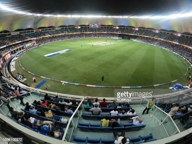 Spectators watch the 5th cricket match of Asia Cup 2018 between India and Pakistan at Dubai International cricket stadiumDubai United Arab Emirates