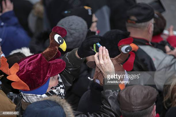 Spectators watch the 88th Annual Thanksgiving Day Parade outside Macy's Department Store in Herald Square on November 27 2014 in New York City