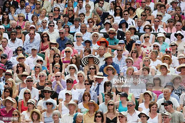 Spectators watch the action during the women's singles final match between Venus Williams of USA and Serena Williams of USA on Day Twelve of the...