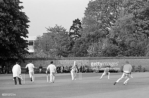 Spectators watch the action from the boundary during the university match between Cambridge University and Middlesex at Fenner's Cambridge 8th May...