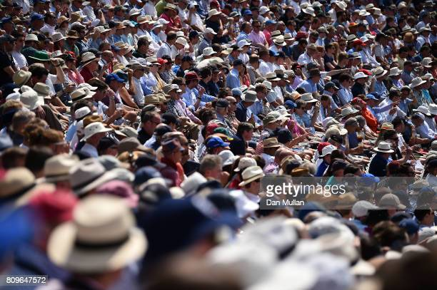 Spectators watch the action from the grandstand during day one of the 1st Investec Test Match between England and South Africa at Lord's Cricket...