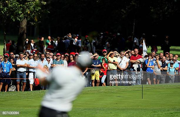 Spectators watch the action on the first hole during the fourth round of the Italian Open at Golf Club Milano Parco Reale di Monza on September 18...