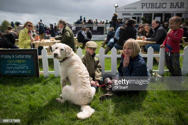 Spectators watch the action on the penultimate day of the Badminton Horse Trials on May 10 2014 in Badminton England The Badminton Horse Trials which...