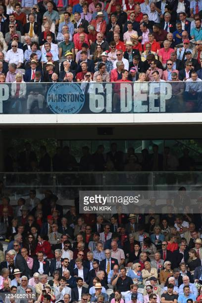 Spectators watch the action on the second day of the second cricket Test match between England and India at Lord's cricket ground in London on August...