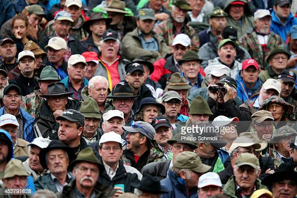 Spectators watch the Alpine Wrestling Festival BruenigSchwinget at the top of the Bruenig Pass on July 27 2014 in Meiringen Switzerland