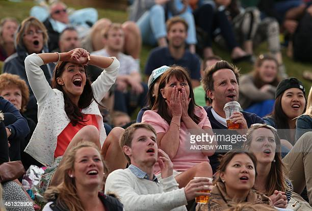 Spectators watch the big screen on Murray Mount as Britain's Andy Murray plays against Spain's Roberto Bautista Agut during their men's singles third...