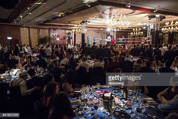 Spectators watch the bout at the Hedge Fund Fight Nite 2016 in Hong Kong China on Friday June 17 2016 The annual event sees finance industry...