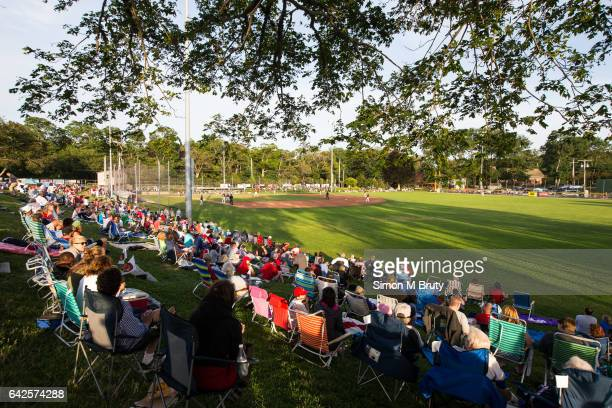 Spectators watch the Cape Cod Baseball League game between Brewster Whitecaps v Orleans Firebirds at Eldridge Park on July 17 2015 in Orleans Cape...