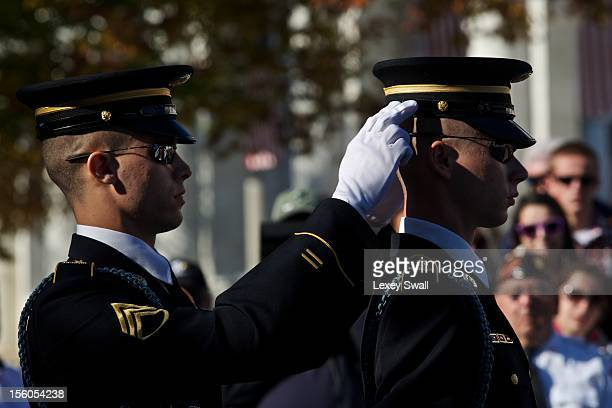 Spectators watch the Changing of the Guard before the Presidential WreathLaying Ceremony on Veterans Day at the Tomb of the Unknowns in Arlington...