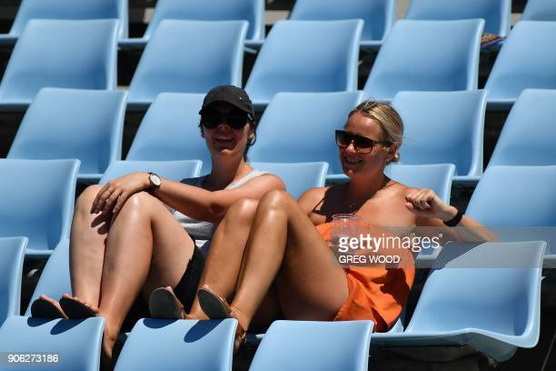 Spectators watch the Czech Republic's Lucie Safarova play against Romania's Sorana Cirstea during their women's singles second round match on day...