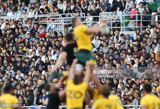 Spectators watch the final game of the threematch Bledisloe Cup series between Australia and New Zealand at Nissan Stadium in Yokohama Japan on Oct...