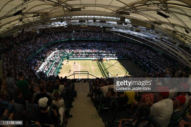 Spectators watch the final match of the ATP tennis tournament in Halle, western Germany, of David Goffin from Belgium against Roger Federer from...