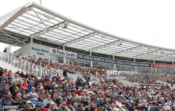 Spectators watch the first One day International cricket match between England and West Indies from the Shane Warne Stand officially opened today at...
