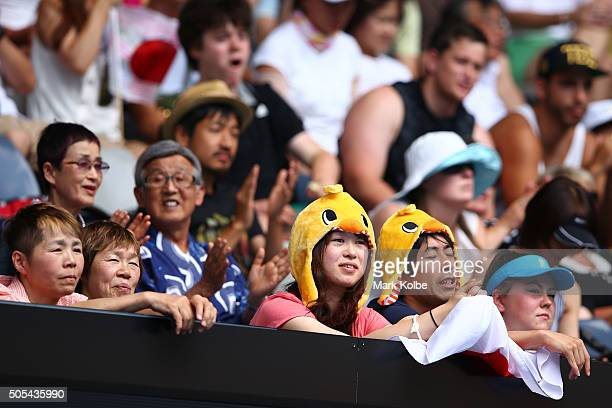Spectators watch the first round match between Kei Nishikori of Japan and Phillip Kohlschreiber of Gemany during day one of the 2016 Australian Open...