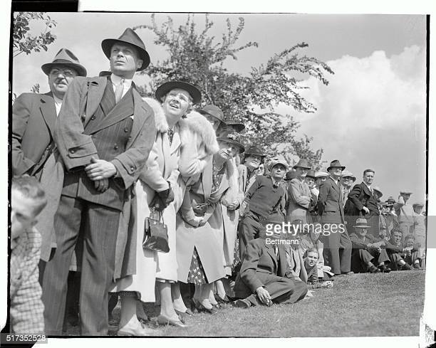 Spectators watch the flight of the ball during a driving contest on September 16th, which served as a curtain-raiser for the Western Open Golf...