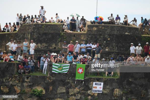 Spectators watch the game from the Fort Walls during Day Two of the First Test match between Sri Lanka and England at Galle International Stadium on...