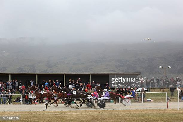 Spectators watch the harness racing during the Roxburgh Trotting Club Summer Festival Races Roxburgh Otago New Zealand 5th January 2012