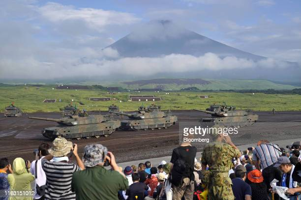 Spectators watch the Japan Ground Self-Defense Force tanks move prior to a live fire exercise in the Hataoka district of the East Fuji Maneuver Area...