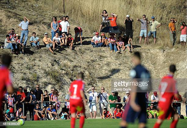 Spectators watch the Jesus Gil y Gil Memorial preseason friendly match between Numancia and Club Atletico de Madrid at the Campo Municipal de...
