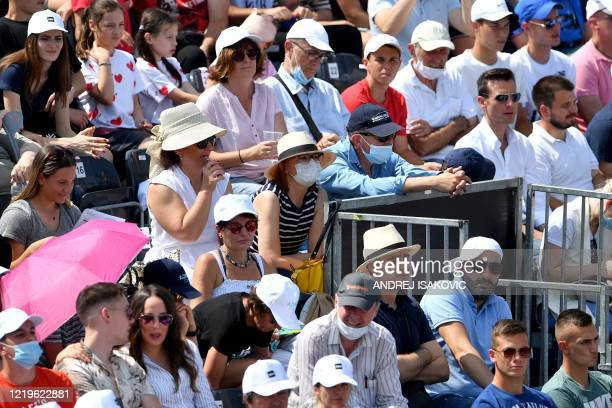 Spectators watch the match between the Serbian tennis player Dusan Lajovic and Bulgarian tennis player Grigor Dimitrov during a charity exhibition...
