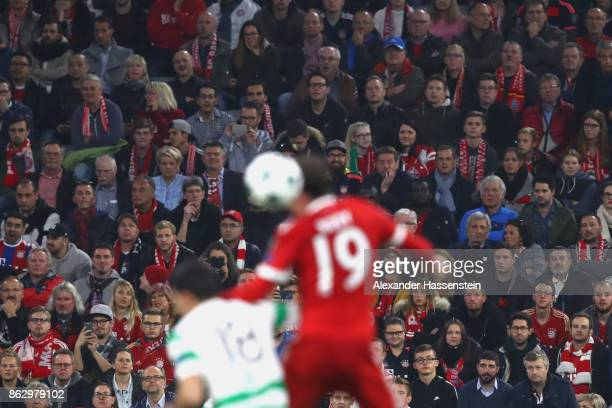 Spectators watch the match during the UEFA Champions League group B match between Bayern Muenchen and Celtic FC at Allianz Arena on October 18, 2017...