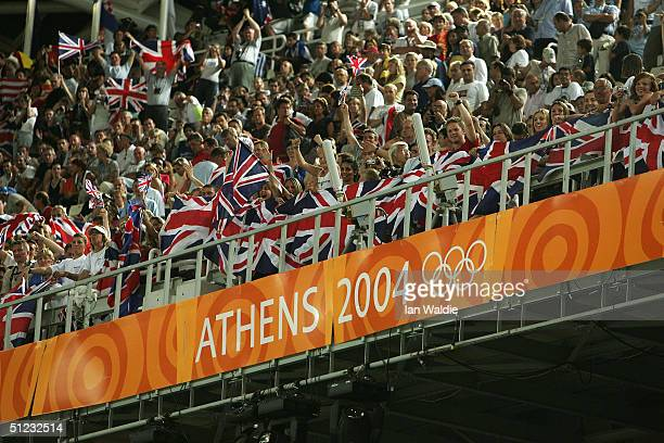 Spectators watch the men's 4 x 100 metre relay final on August 28, 2004 during the Athens 2004 Summer Olympic Games at the Olympic Stadium in the...