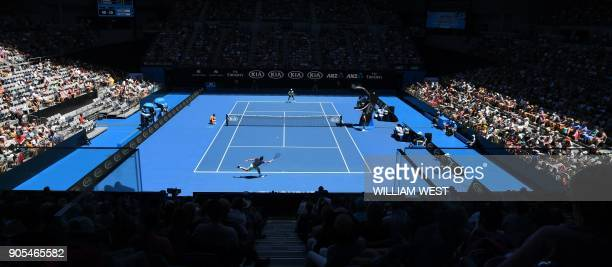 TOPSHOT Spectators watch the men's singles first round match between Switzerland's Stanislas Wawrinka and Lithuania's Ricardas Berankis on day two of...