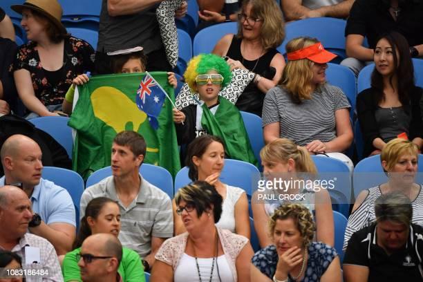 Spectators watch the men's singles match between Australia's Alex de Minaur and Switzerland's Henri Laaksonen on day three of the Australian Open...