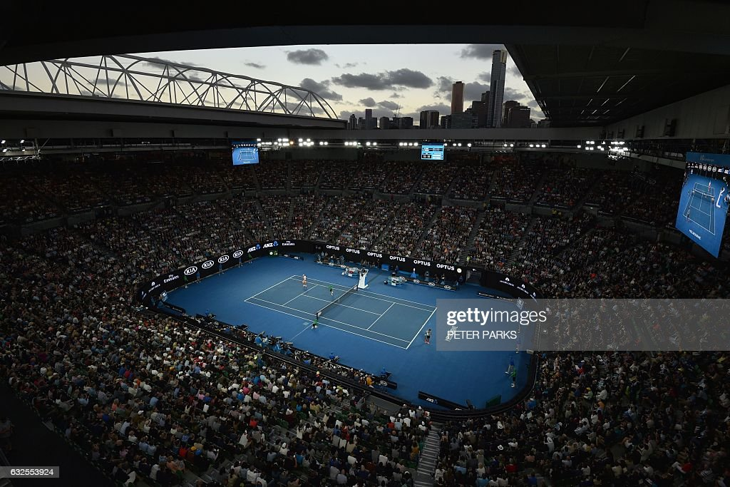 TOPSHOT - Spectators watch the men's singles quarter-final match between Switzerland's Roger Federer and Germany's Mischa Zverev on day nine of the Australian Open tennis tournament in Melbourne on January 24, 2017. / AFP / PETER