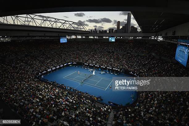 TOPSHOT Spectators watch the men's singles quarterfinal match between Switzerland's Roger Federer and Germany's Mischa Zverev on day nine of the...