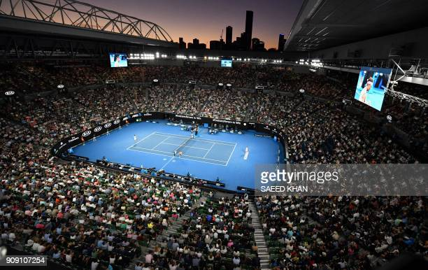 TOPSHOT Spectators watch the men's singles quarterfinals match between Spain's Rafael Nadal and Croatia's Marin Cilic on day nine of the Australian...