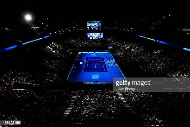 Spectators watch the men's singles round match between Mardy Fish of USA and JoWilfried Tsonga of France during the Barclays ATP World Tour Finals at...