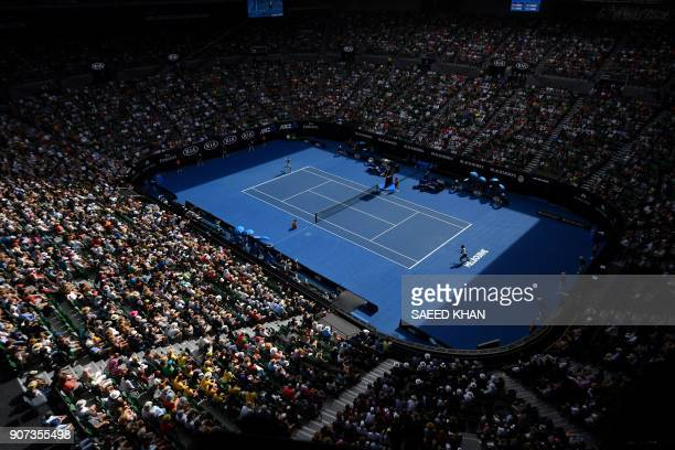 TOPSHOT Spectators watch the men's singles third round match between Germany's Alexander Zverev and South Korea's Hyeon Chung on day six of the...