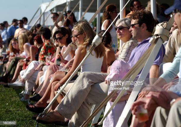 Spectators watch the Mercedes-Benz Polo Challenge July 21, 2001 in Bridgehampton, NY. The Hamptons, located at the east end of New York''s Long...