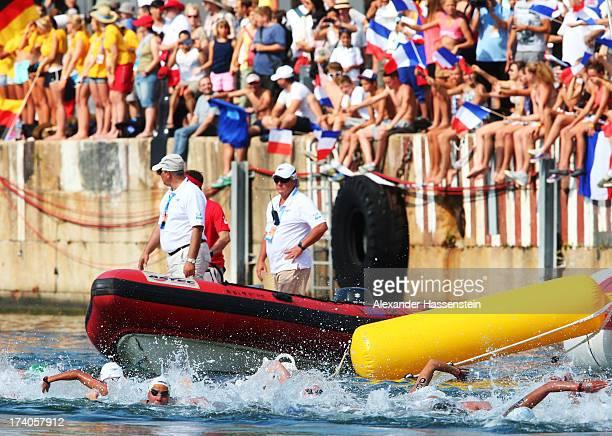Spectators watch the Open Water Swimming Women's 5k race on day one of the 15th FINA World Championships at Moll de la Fusta on July 20 2013 in...