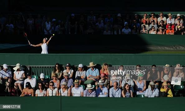 Spectators watch the play at The All England Tennis Club in Wimbledon southwest London on July 2 on the first day of the 2018 Wimbledon Championships...