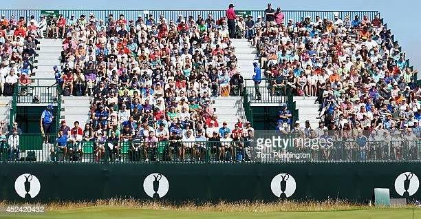 Spectators watch the play at the seventh green during the final round of The 143rd Open Championship at Royal Liverpool on July 20 2014 in Hoylake...