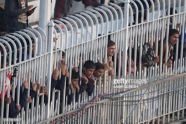 Spectators watch the play during the first day of the first Test cricket match between Pakistan and Sri Lanka at the Rawalpindi Cricket Stadium in...