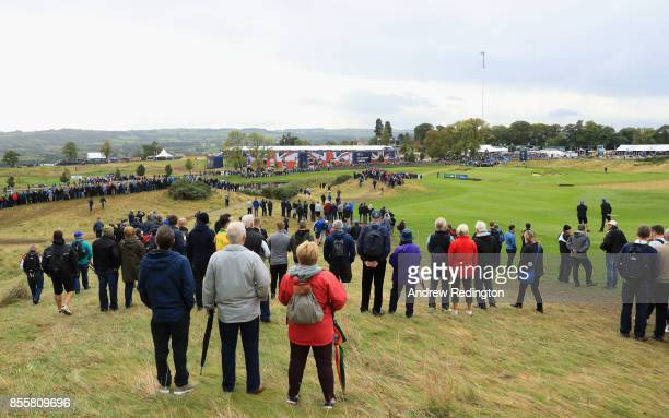 Spectators watch the play on the 4th and 5th holes during day three of the British Masters at Close House Golf Club on September 30 2017 in Newcastle...